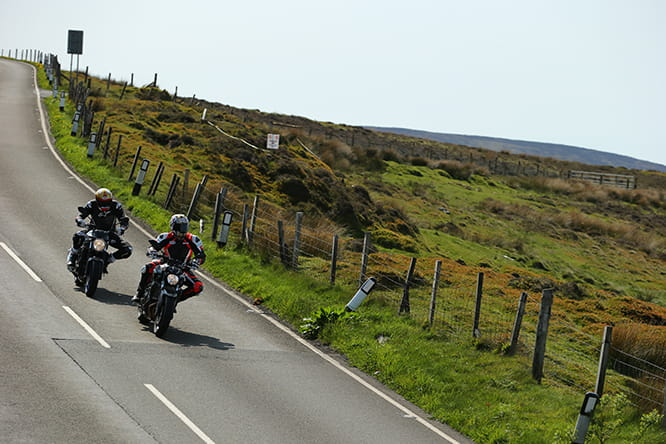 Suzuki and Yamaha heading to Guthries Memorial the wrong way around the TT course