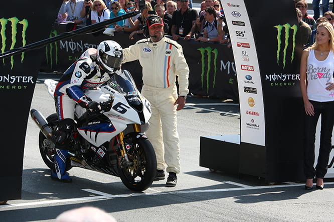 Michael Dunlop on his Dymag equipped BMW S1000RR about to set off towards another TT victory in 2014.