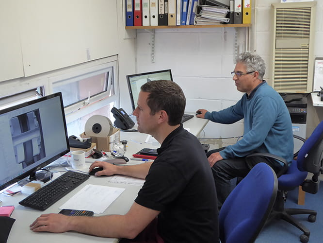 Chief Engineer Mike Wilson (furthest from camera) and Design Engineer Chris Papworth are the technical powerhouse of Dymag. Mike invented the first all-carbon motorcycle wheel in 1995.