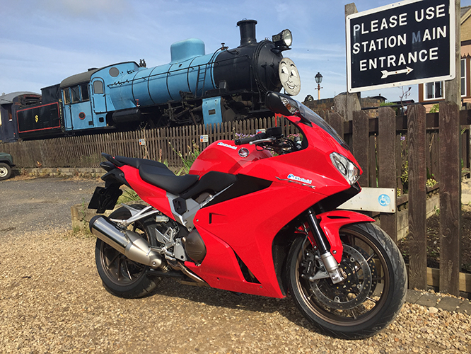Honda VFR800F has a 22 litre tank. Not as good as Thomas'.