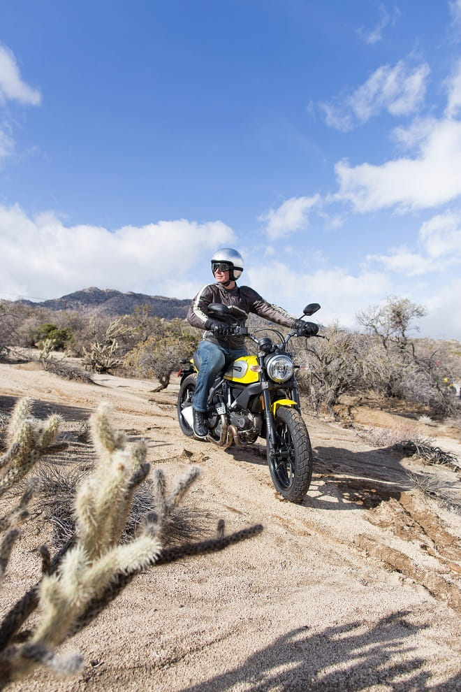Ducati's Scrambler strikes a pose off-road. Roland does too.